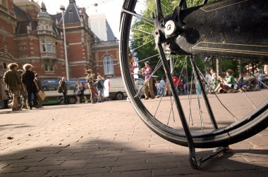 Street scene through the bike wheel