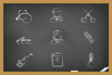 Medical icons drew on blackboard