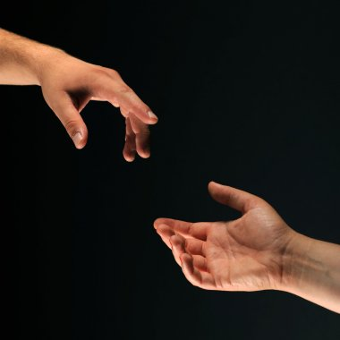 Two hands reaching to each other