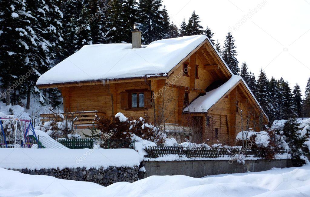 Chalet in Jura mountain by winter