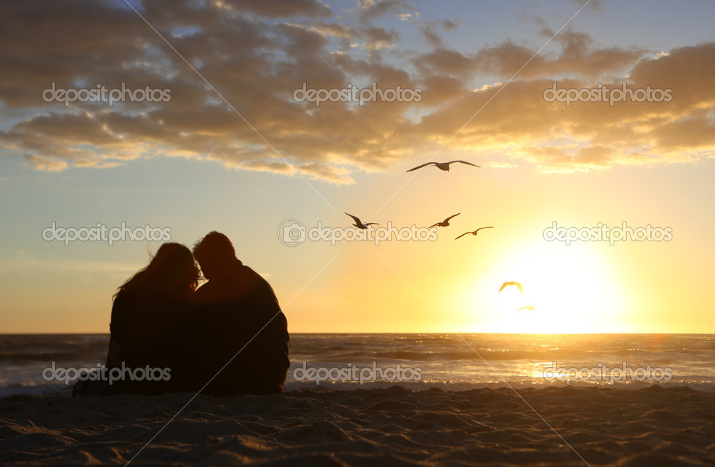 Happy Couple Watching the Sunset in Love on the