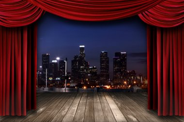 Theater Stage Curtain Drapes With a Night City as a Backdrop
