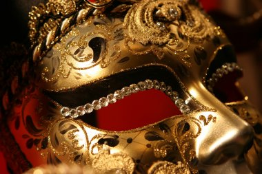 Venetian mask on red background