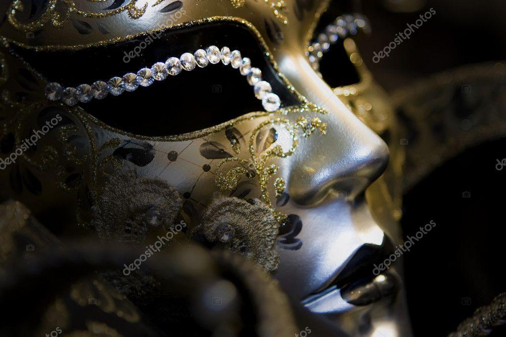 Part of venetian mask on black background