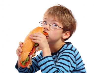Boy eating large sandwich