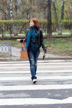 Girl crossing the street