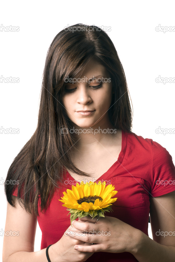 Young girl holding sunflower