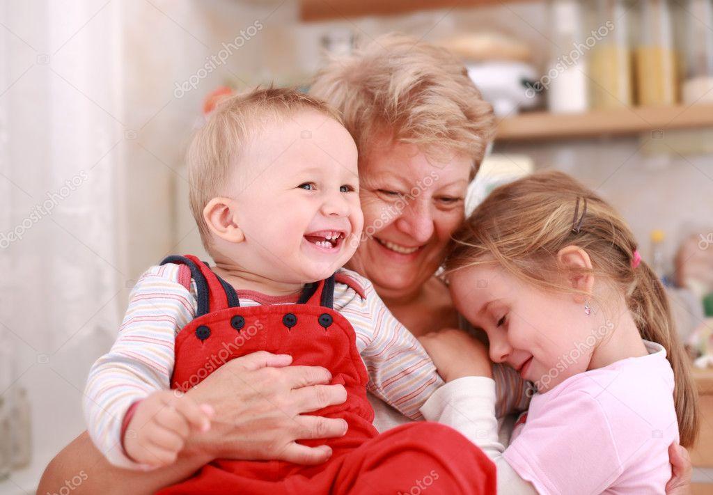 Happy children with granny