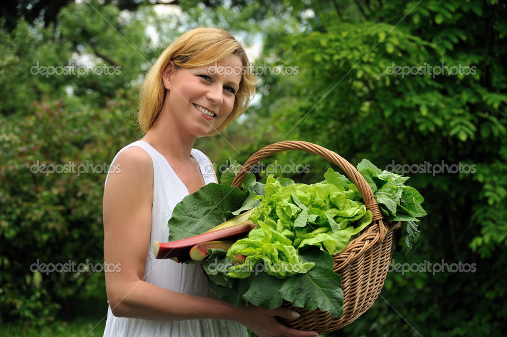 Young woman holding vegetable