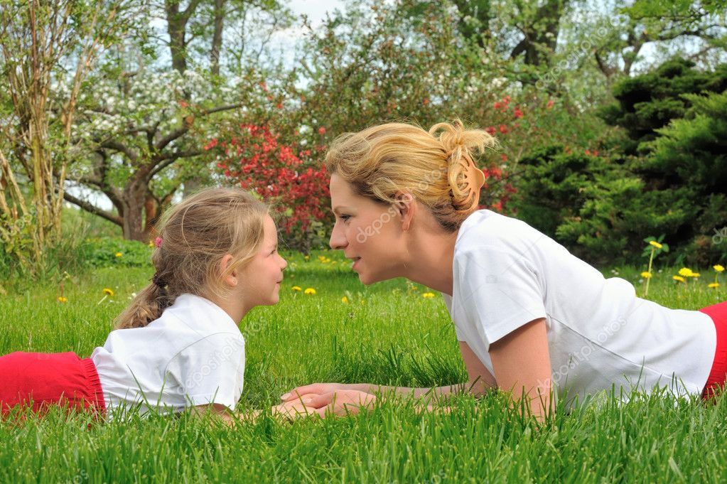 Young mother and daughter playing