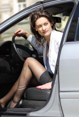 Woman parks the car