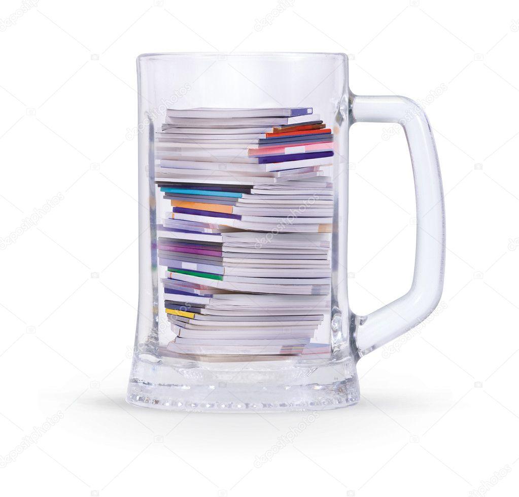 Mug of pile magazines
