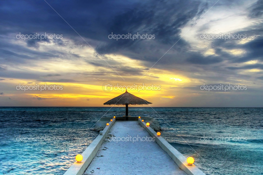 Maldivian umbrella sunset