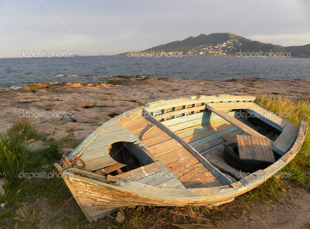 Old boat on the beach — Stock Photo © andreasnikolas #3522758