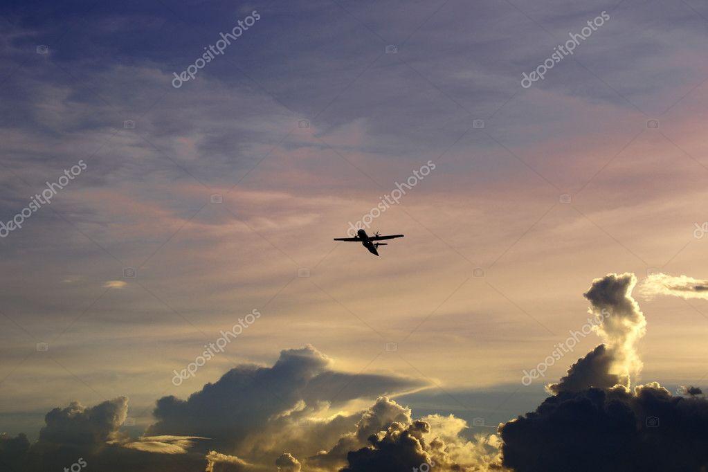 The plane flies in the sky of Borneo.