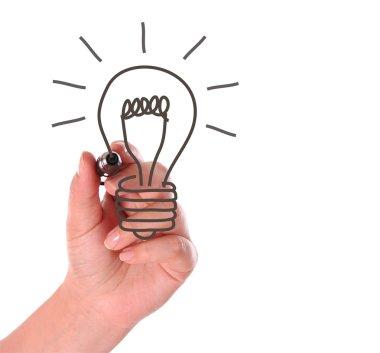 Woman hand drawing light bulb