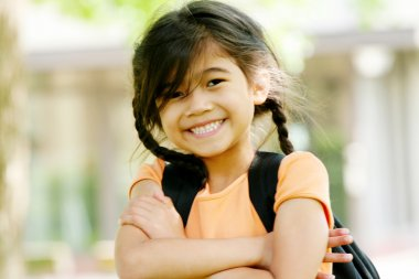 Adorable five year old girl ready for first day of school;