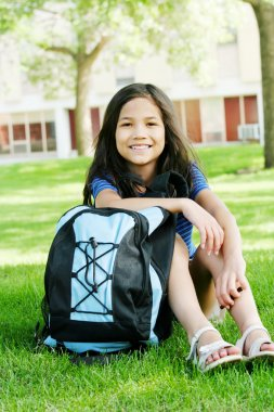 Eight year old girl excited about first day of school.;