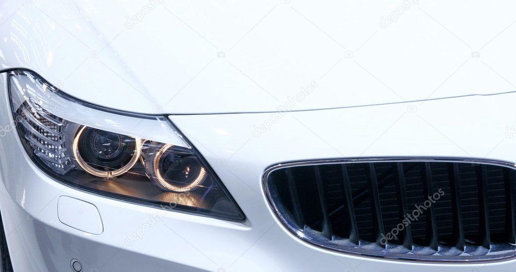 Headlights of new white car