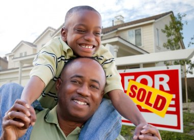African American Man and Child with Home