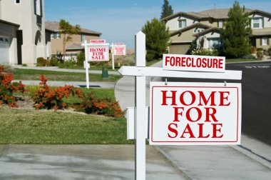 Row of Foreclosure Real Estate Signs