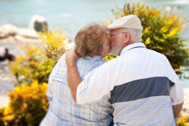 Happy Senior Couple Kissing at Park