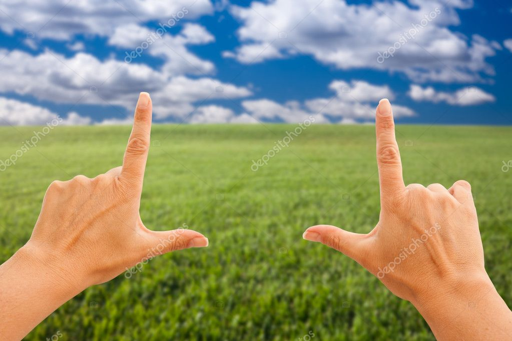 Hands Making a Frame Over Grass Field
