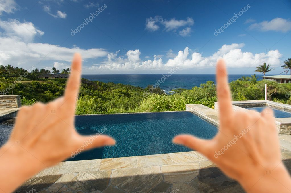 Hands Framing Pool and Hot Tub Overlooking View