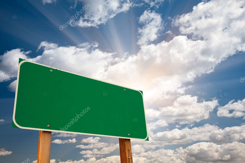Blank Green Road Sign over Dramatic Sky