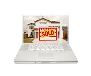 Sold For Sale Real Estate Sign on Laptop