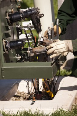 Utility Workers with Leather Gloves Installing New Electrical Equipment.