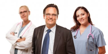 Smiling Businessman with Female Doctor and Nurse