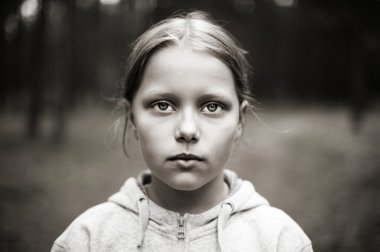 Black and white portrait of tired little girl with sad eyes