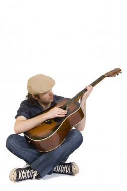 Seated guitarist