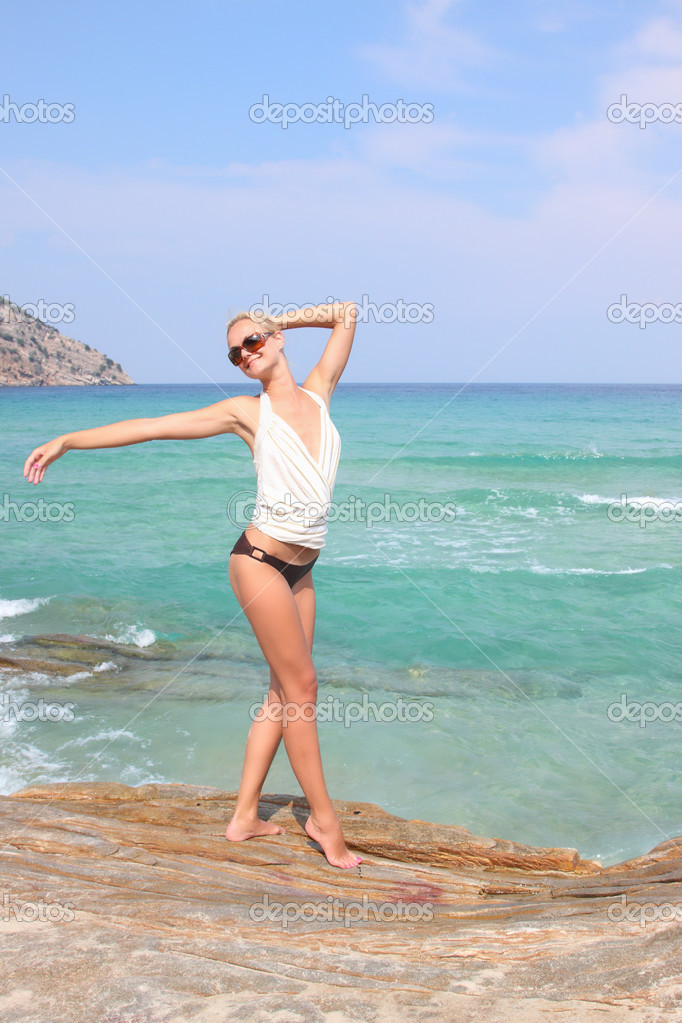 Beautiful woman enjoying the beach