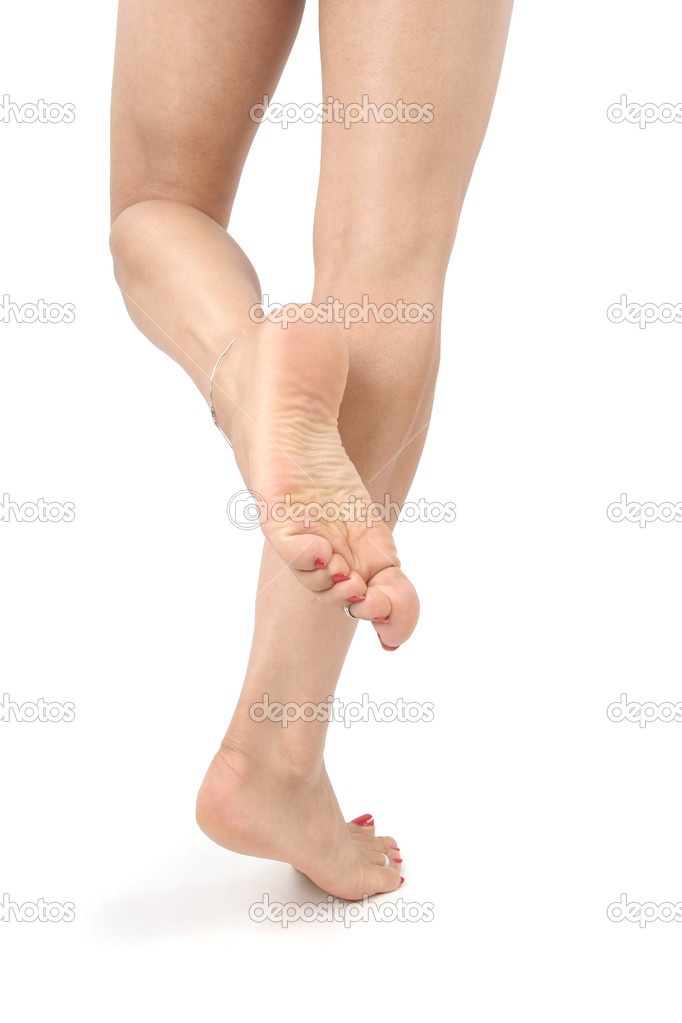 Woman legs and feet isolated over white — Stock Photo © Strobos #2870370