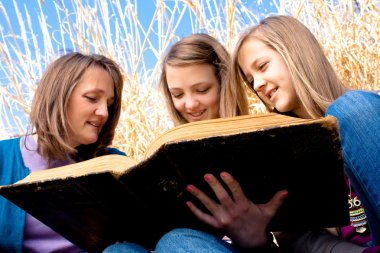 Mother and Daughters Reading