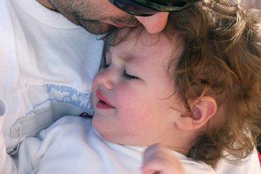 Daddy comforting daughter