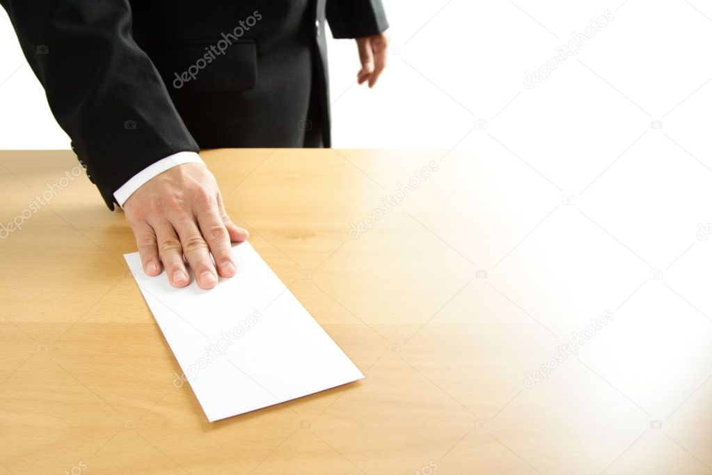 A businessman handing in a blank envelope