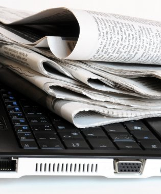 Newspapers on the laptop
