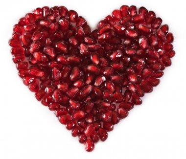 Heart shaped pomegranate seeds, high key