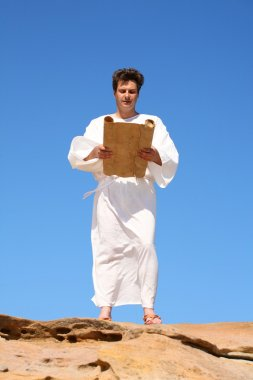 Man in traditional robe reading scroll