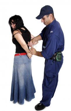 An officer apprehending a female