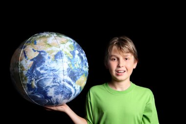 Boy holds world earth ball in his hand