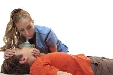Nurse using resuscitation mask