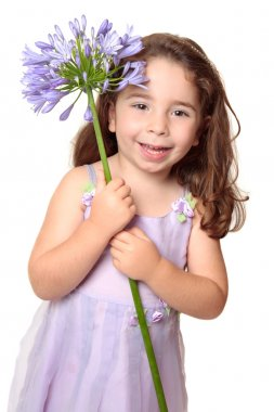 Little girl holding large african lily