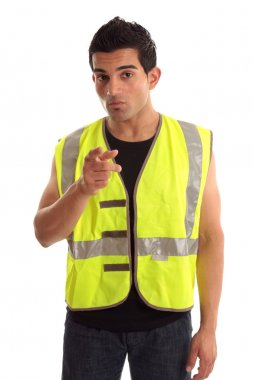 A construction worker, repairman, tradesman wearing safety vest is pointing his finger. stock vector