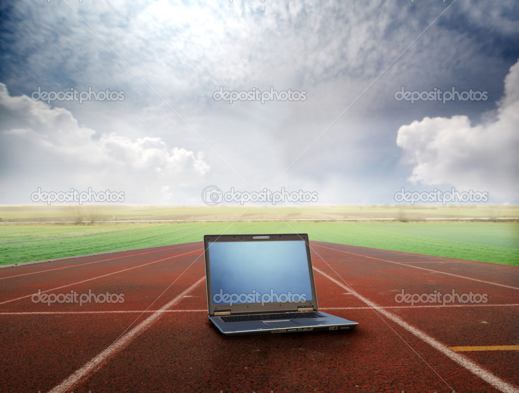 Laptop lying on a running track