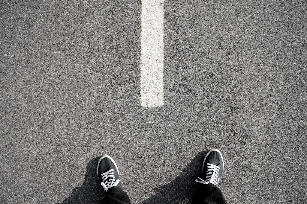 Man's feet on a street
