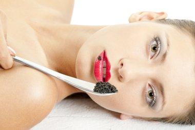Woman with black caviar